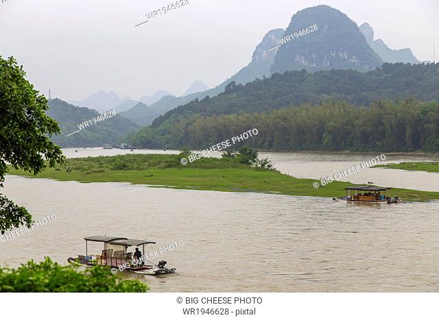 View of bamboo rafts on the Li River from the temple, Yangshuo, China