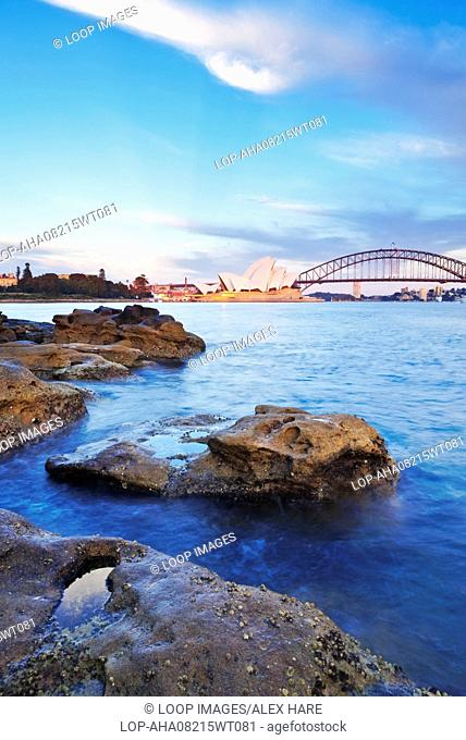 A view of Sydney harbour and opera house at dawn