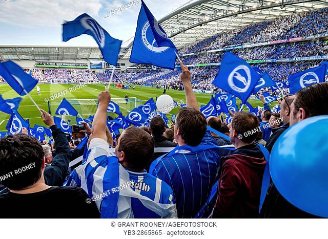 Brighton and Hove Albion Football Fans Cheer Their Team On To The Pitch For The Final Game Of The Season After Securing Promotion To The Premier League