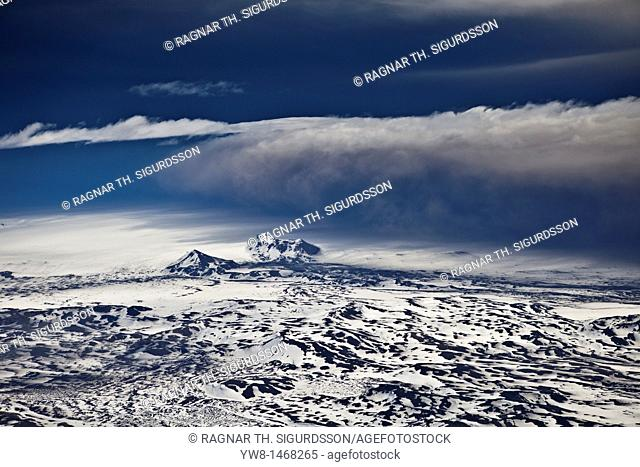 Grimsvotn Volcanic Eruption in the Vatnajokull Glacier, Iceland  Ash seen in the clouds, snow, and ice approx 20-40 kilometers away  The eruption began on May...