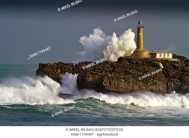 Mouro island and lighthouse in a storm  Santander  Cantabria, Spain