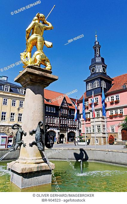 Statue of the patron saint St George above the market fountain, at back the Town Hall, Eisenach, Thuringia, Germany, Europe