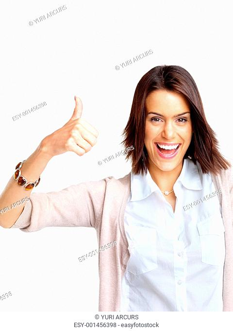 Portrait of a smiling young woman showing thumbs up sign against white background