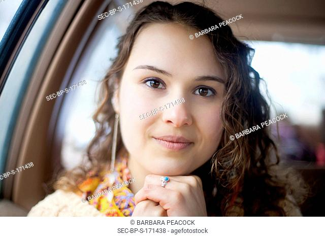 Portrait of young woman (18-19) in car
