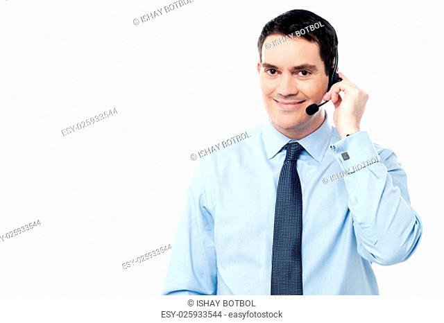 Middle aged smiling call centre executive