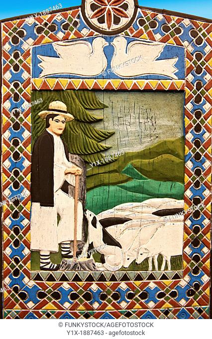 Tombstone of a shepherd in the fields, The Merry Cemetery Cimitirul Vesel, Maramares, Northern Transylvania, Romania The naive folk art style of the tombstones...