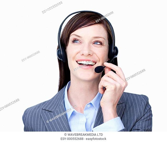 Portrait of a young customer service agent with headset on against white background