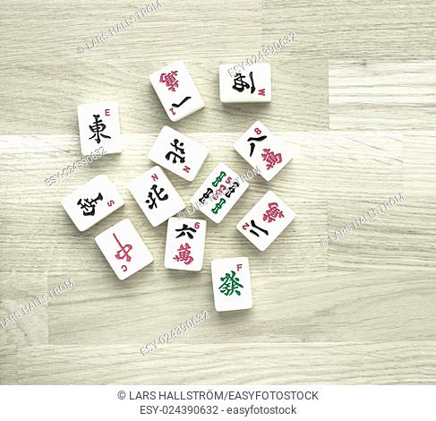 Mahjong board game pieces lying on wood table from above. Concept of asian or chinese leisure activity, recreation and traditional games