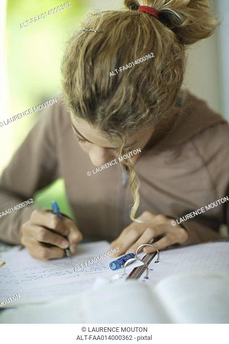 Preteen girl doing homework