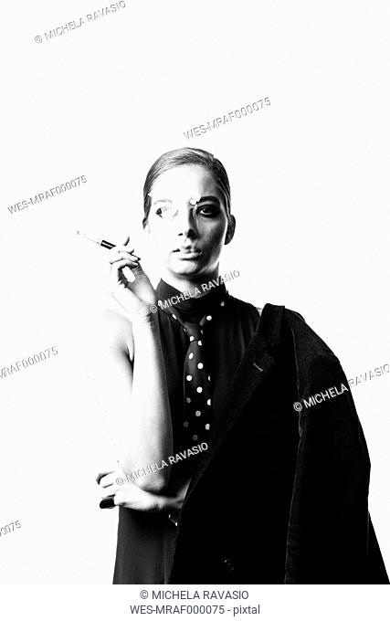 Portrait of stylish woman smoking a cigarette