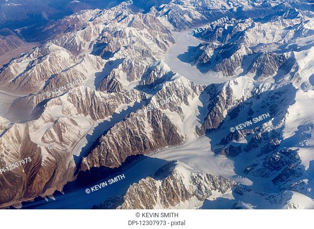 Aerial view of the Tordrillo Mountains, and glaciers running between them, Alaska Range, South-central Alaska; Alaska, United States of America
