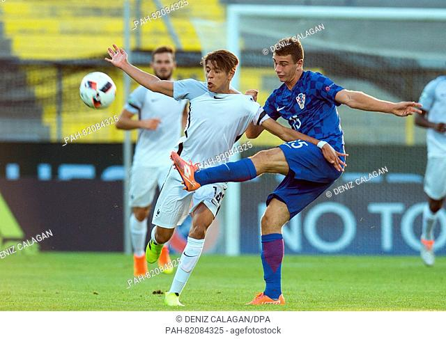 France's Amine Harit (l) and Croatia's Marijan Cabraja compete for the ball during the UEFA European Under-19 Championship group B soccer match between Croatia...