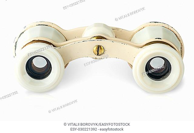 In front old vintage pair of opera glasses horizontally isolated on white background