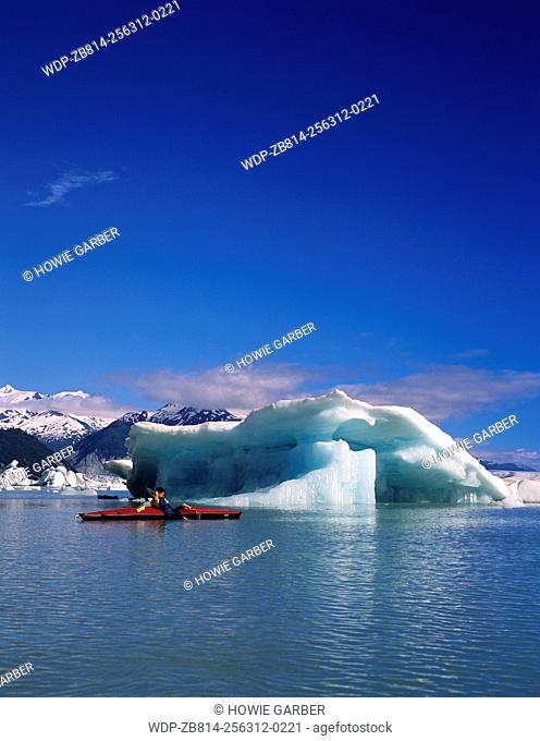 Kayaker P.J. in awe of icebergs on Alsek Lake, Glacier Bay National Park & Preserve, Alaska