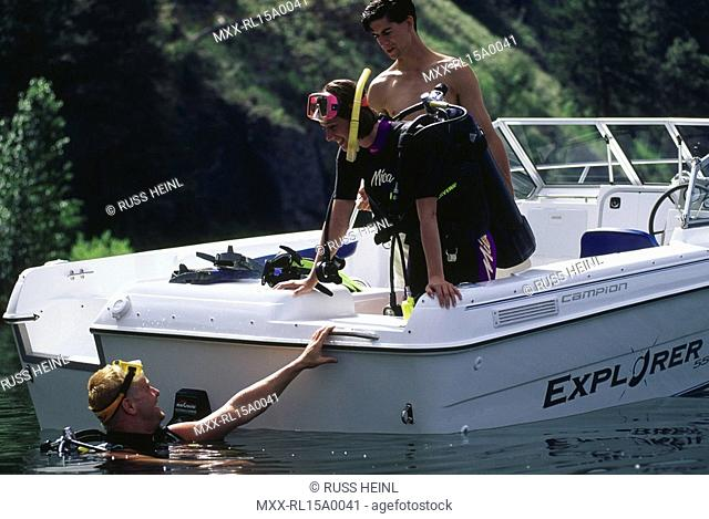 scuba divers getting into boat