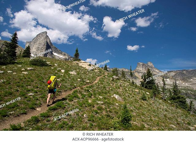 Hiker approaching Mount Gimli, Selkirk Mountains. Valhalla Provincial Park, British Columbia, Canada