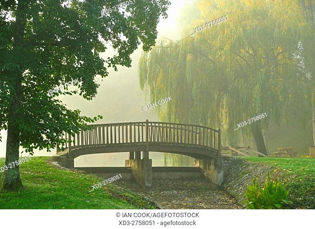 foot bridge in municipal park in fog, Lauzun, Lot-et-Garonne Department, Aquitaine, France