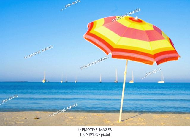 Yellow and red sunshade on the beach