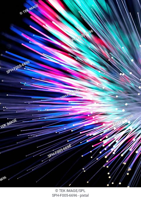 Optical fibres emitting light. Optical fibres are used in telecommunications to transmit data at high speed
