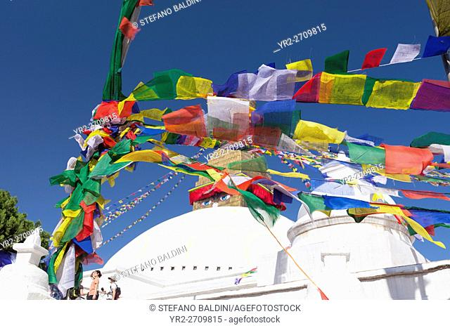 Prayer flags swept by the wind at the famous stupa of Boudhanath, Kathmandu, Nepal