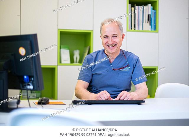 26 April 2019, Rhineland-Palatinate, Pirmasens: Dentist Michael Menzel sits in his practice in Pirmasens. Menzel plans to convert an ambulance into a mobile...