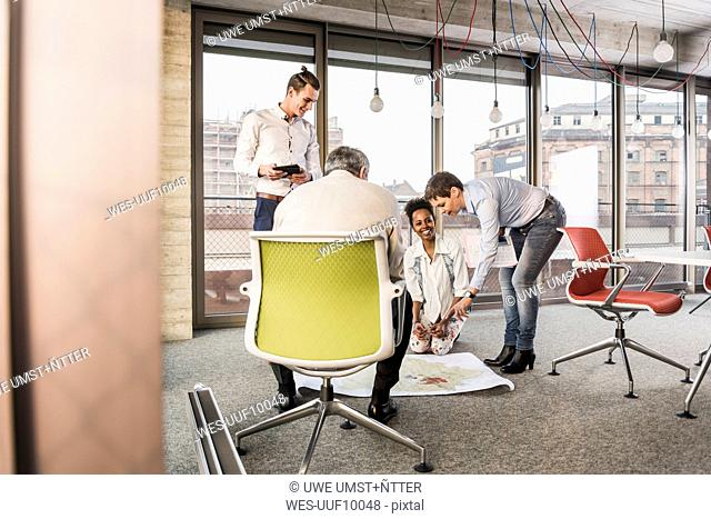 Businesspeople working on a project in office