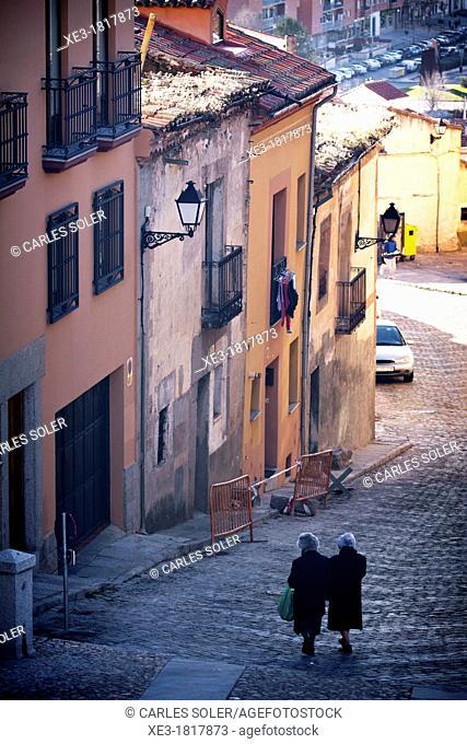 Two elderly women going down steep street, Ávila, Spain
