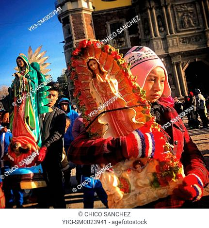 Pilgrims carry images of the Virgin of Guadalupe during the annual pilgrimage to the Our Lady of Guadalupe Basilica in Mexico City, Mexico