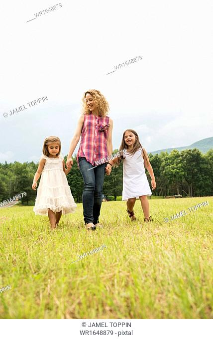 Mother playing outdoors with her daughters