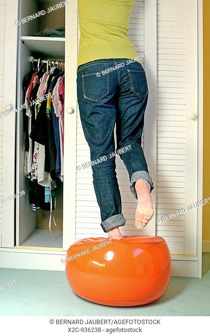 girl doing putting away