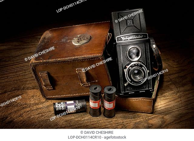 Wales, Monmouthshire, Monmouth. Vintage Voigtlander Brilliant camera with leather case and roll films