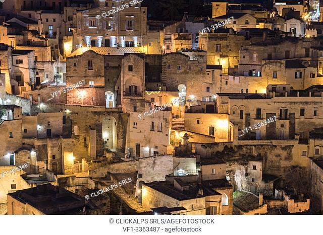 Close-up on the old houses of the Sassi quarter at night. Matera, Basilicata region, Italy