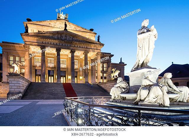 Schiller Statue and Konzerthaus in Gendarmenmarkt square in the evening in Mitte Berlin Germany