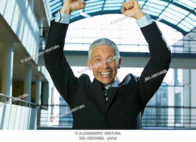 portrait of mature businessman celebrating success