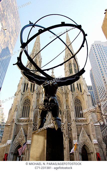 5th Avenue, statue of Atlas and cathedral of Saint Patrick. New York City. USA