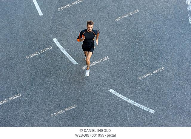 Man running on street with markings