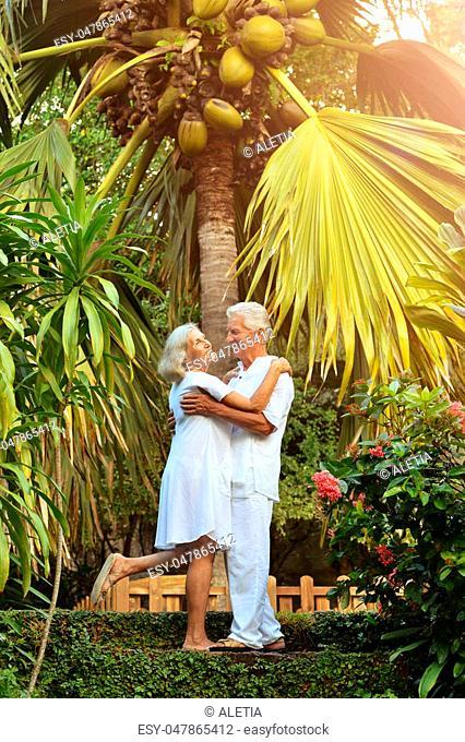 portrait of beautiful caucasian senior couple in the park dancing