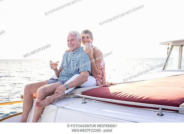Happy couple having a drink on a boat trip