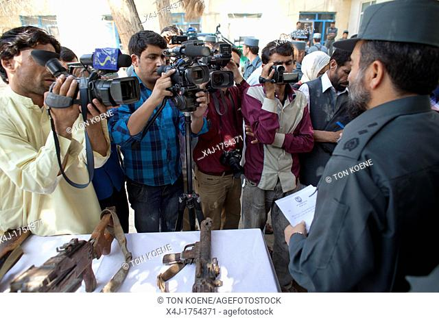 afghan police in Kunduz give a press conference about preventing a bomb explosion