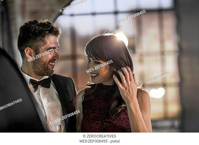 Smiling couple in elegant clothing