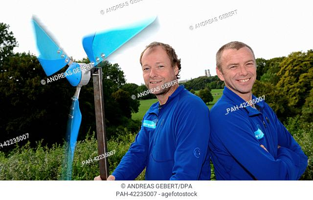 Artists Thomas Huber (L) and Wolfgang Aichner pose with a self-made wind turbine inthe English garden in Munich, Germany, 27 August 2013