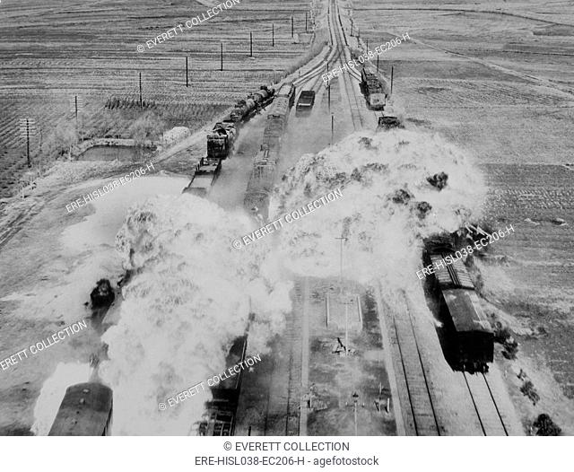 Two fireballs of napalm explode on North Korean railroad cars on the main rail line from Wonsan. Bombs of jellied gasoline were dropped from U.S