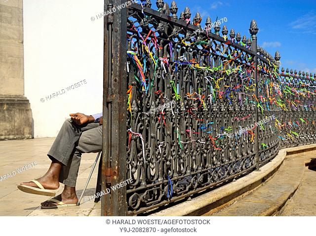 Brazil, Bahia, Salvador: Handicapped person tactfully collecting money at the church gate to Igreja do Bonfim (1754) on Salvador's peninsula Itapagipe