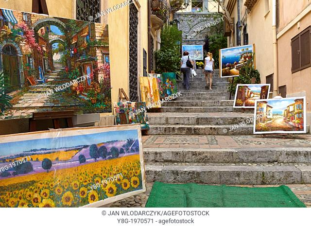 Paintings for sale, Corso Umberto, old town in Taormina, Sicily, Italy