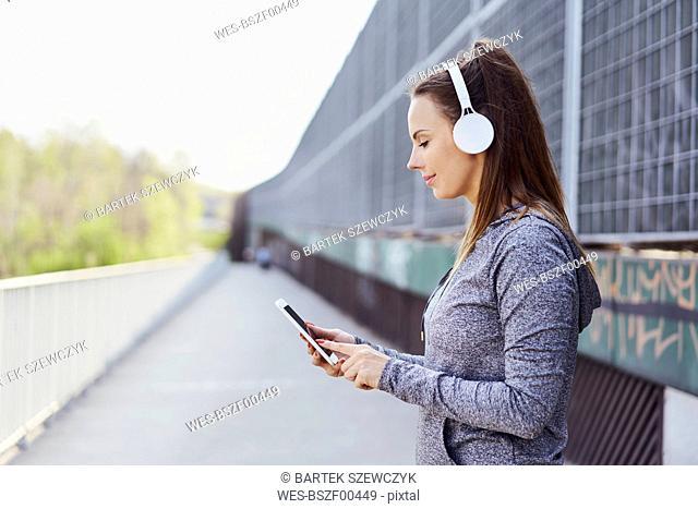 Woman with headphones using smartphone