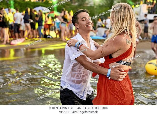 Greece, Crete, Chersonissos, couple at Beach Party in sea, flirting