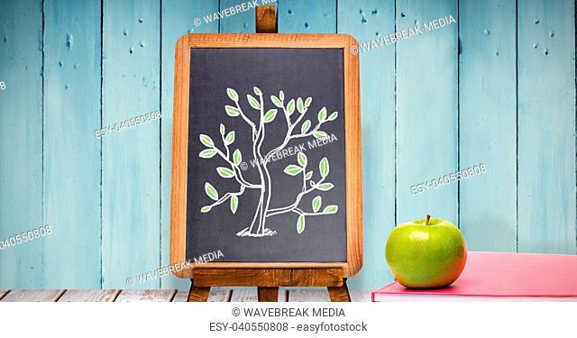 Tree drawing on blackboard with apple