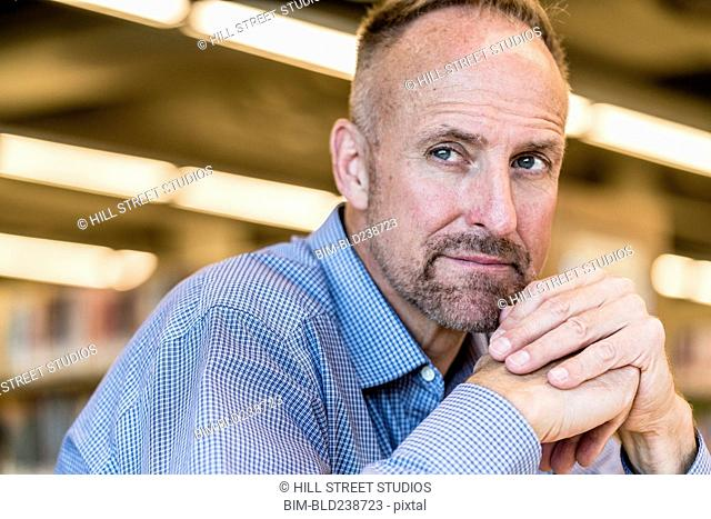 Portrait of pensive Caucasian businessman