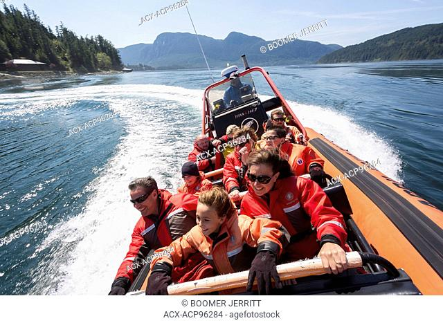 Passengers aboard a Zodiak experience the thrill of running through the Arran Rapids during a fast flowing flood of water