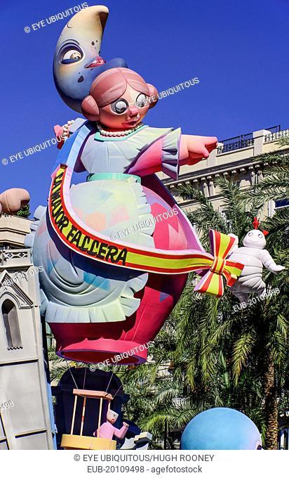 Las Fallas scene with Papier Mache figure on a Bus Turistic in Plaza Ayuntamiento during Las Fallas festival